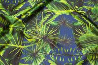 Stræk-satin i lys marine med grønne jungleblade