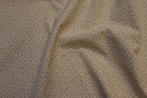 Småmønstret bomuld i sand og off-white