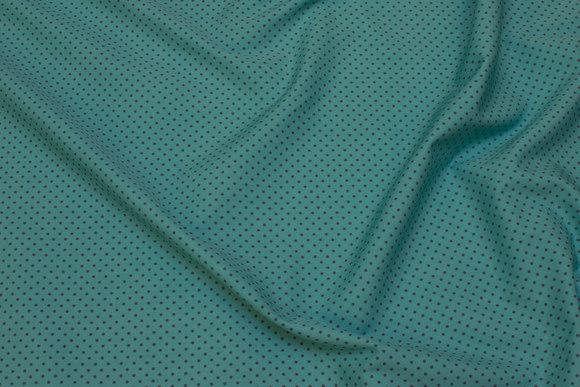 Turkisgrøn bomuldspoplin med marine miniprikker