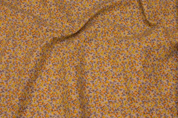 Småblomstret bomuld i sand og gul