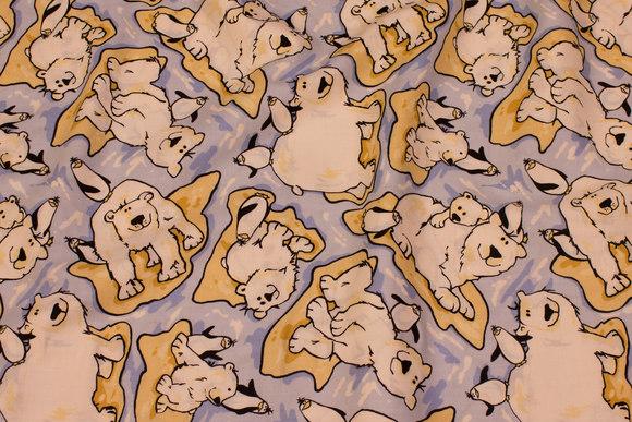 Lyseblå patchwork bomuld med isbjørne og pingviner