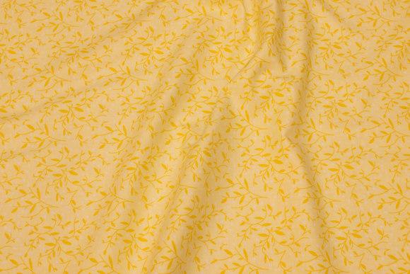 Citrongul patchwork bomuld med gult bladmønster