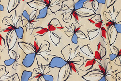 Cremefarvet bomuldsjersey med røde og blå blomster