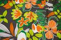 Grå bomuldsjersey med orange blomster i retrostil.
