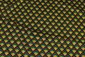 Marine heavyjersey med mønster i gul og jadegrønt.