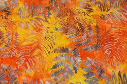 Patchwork bomuld i batik i orange og gule farver med blade