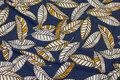 Støvblå viscose-jersey med blade i hvid og gul.