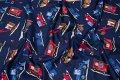 Mørkeblå patchworkbomuld med maskiner i blå og røde farver. Rigtig flot og stærkfarvet vare. Velegnet til sengetøj, gardiner, puder m.m.