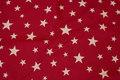 Vinterrød bomuld og polyester i stor bredde med stjerner