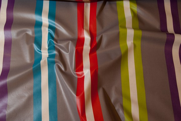 Grå textildug eller bomuldscanvas med striber