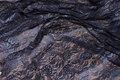 Batikfarvet strækblonde i mørkbrun og dueblå.