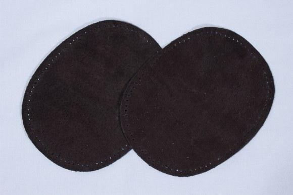 Mørkebrune, ovale lapper i ægte skind 2 stk
