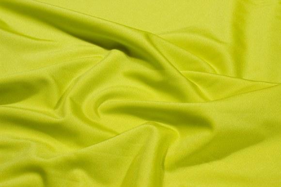 Neon grøn-gul stretchlycra til dansetøj, toppe og leggings.