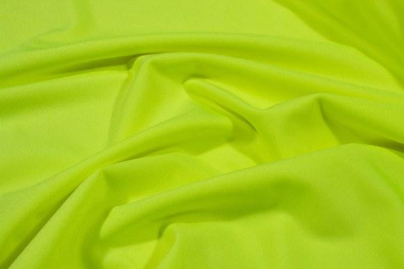 Neongulstretchlycra til dansetøj, toppe og leggings.
