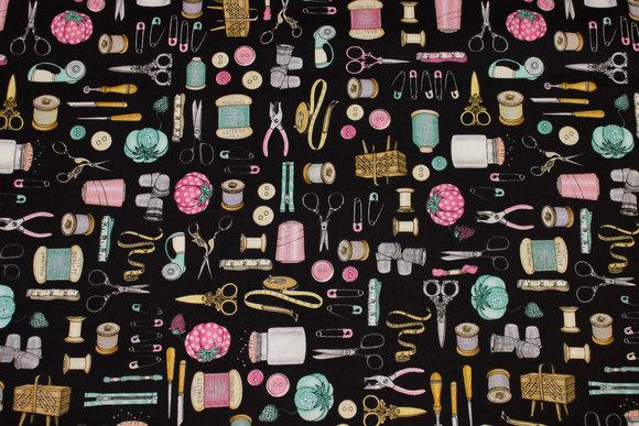 Sort patchwork-bomuld med symotiver