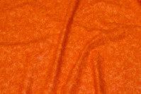 Vævet bomuld med diskrete blomster i orange
