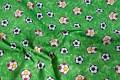 Grøn bomuld med fodbolde.