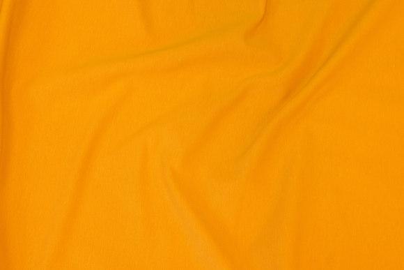 Let joggingstof i mørk gul