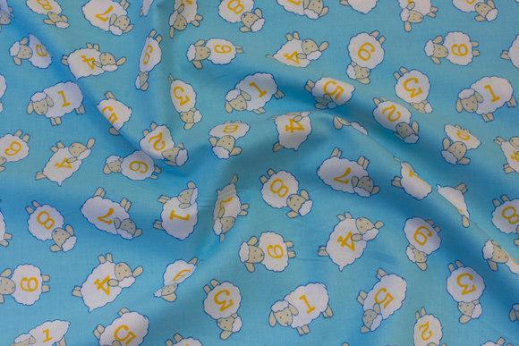 Lyse blå patchwork bomuld med små får