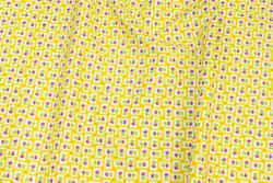 Patchwork-bomuld med lille gul tern og lilla blomst