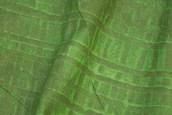 Patchwork-bomuld i støvede grønne nuancer