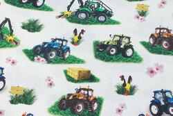 Lys bomuld med ca. 10 cm traktorer