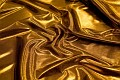 Guldfarvet polyesterjersey med folietryk. 69 kr.