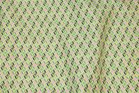 Fast bomuld med lille retromønster i grønne nuancer med lidt pink