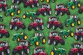 Græsgrøn bomuldsjersey med traktorer.