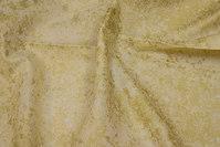 Creme patchwork-bomuld med guldtryk