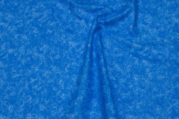 Himmelblå bomuld i batik-look med blomster