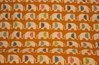 Økologisk orange bomuld med elefanter på række.