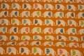 Økologisk orange bomuld med elefanter på række..