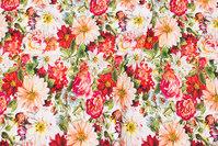 Bomuldsjersey med sommerblomster i røde nuancer