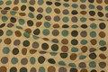 Coated tekstildug med store prikker.
