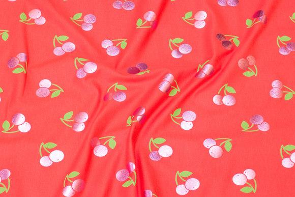 Coralrød bomuldsjersey med blanke, pink kirsebær
