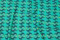 Jadegrøn bomuldsjersey med ca. 4 cm bladmønster.