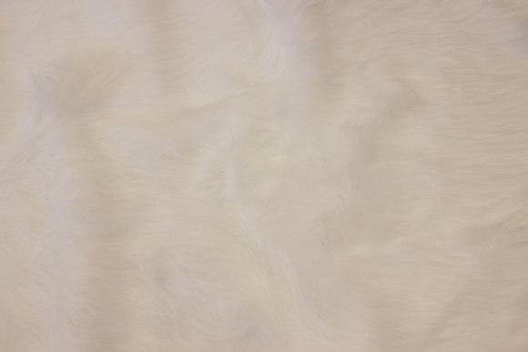 Langhåret pels i hvid