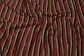 Antipilling-fleece med striber i grøn, brun og rød.