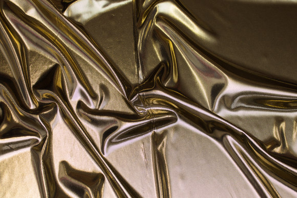Blød guld-folietryk med sort jerseybagside.