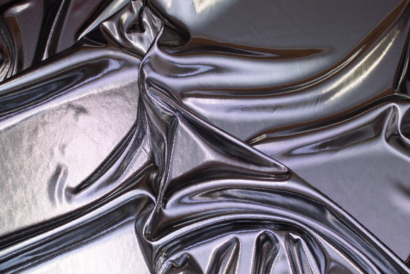 Blød sølv-folietryk med sort jerseybagside