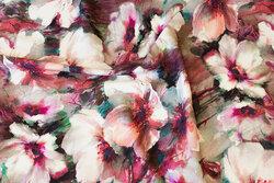 Bomuldsjersey med blomster i rødlilla nuancer