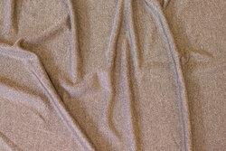 Let jersey i meleret jordfarvet med let blank overflade