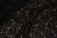 Let, sort blonde med diskret guldglimmer og spredte sorte pailletter