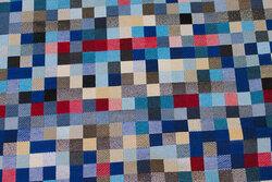 Møbel-gobelin i flotte blå nuancer med lidt sølv og rødt