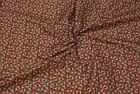 Rød julebomuld med kristtjørn i grøn og guld