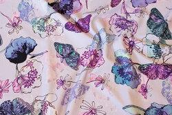 Sart lyslilla bomuldsjersey med blomster og sommerfugle