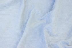 Dobbeltvævet bomuldscrepe (gauze) i sart lysegrå