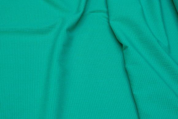 Grøn bomuld og polyester crepe med let stræk