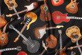Guitars on patchwork-cotton.